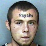 AGWDM psycho forehead tattoo
